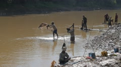 Casting fisherman working in team ,Battambang,Cambodia Stock Footage