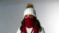 Beautiful girl coughs in winter hat Stock Footage