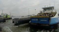 Ferries in the harbor from Amsterdam in the Netherlands time lapse Stock Footage