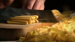 Homemade fresh pasta: cutting pasta with a traditional knife on a wooden table Stock Footage