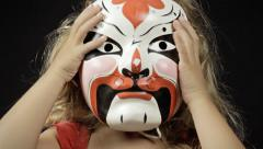 Little girl chinese opera mask 1 Stock Footage