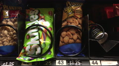 Sour Skittles purchased from vending machine 4k - stock footage
