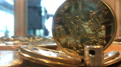 Stock Video Footage of Collectors gold coin from Statue of Liberty rotating 4k