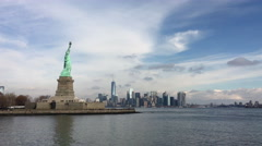Statue of Liberty seen in Hudson bay with NYC in background 4k Stock Footage