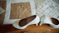 Bride shoes on a wooden railing Stock Footage