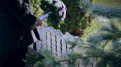 Groom holding bouquet behind his back - stock footage