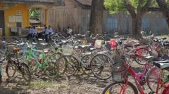 Bicycles parked at school,Battambang,Cambodia Stock Footage