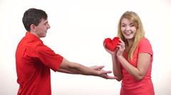 Stock Video Footage of Couple in love. Man giving woman red heart 4K