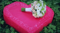 Wedding bouquet on a red heart - stock footage