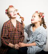 girls play homemakers, do yourself a makeover - stock photo