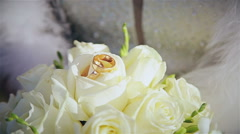 Bouquet of wedding rings in hands of bride - stock footage
