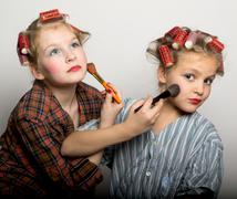 Girls play homemakers, do yourself a makeover Stock Photos