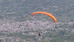 Solo Paraglide Flying Against Populated Area In Andes Stock Footage