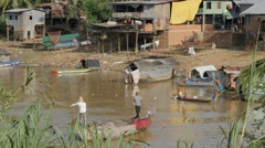 Fishermen slowly peddling in river,Battambang,Cambodia Stock Footage