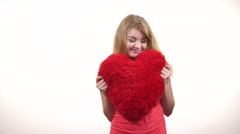 Stock Video Footage of Couple holds red heart shaped pillow love symbol 4K