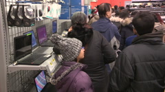 Crowds of bargain hunters on boxing day at electronics retailer Stock Footage