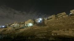 Night time-lapse of a Jordanian city hillside Stock Footage
