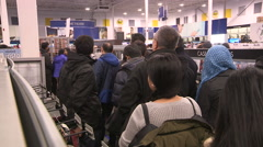 Crowds of bargain hunters on boxing day at electronics retailer - stock footage