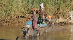 Fishermen drifting in small boat with current,Battambang,Cambodia Stock Footage