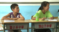 Chinese children singing in English class Stock Footage