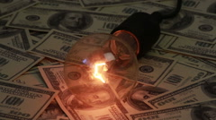 Decorative light bulb and money Stock Footage