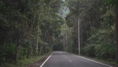 Stock Video Footage of Empty Thai rural jungle road. First person view