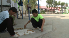 Chinese boys play checkers, Beijing - stock footage