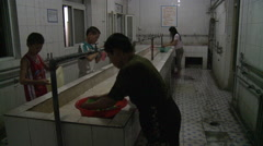 Chinese kids washing clothes, Beijing Stock Footage