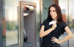 Surprised Businesswoman with Credit Card at ATM cash machine Stock Photos