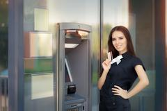 Woman with Credit Card at ATM cash machine - stock photo