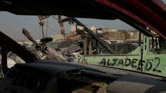 Cars On Scrap Yard. A worker actioning a chain lever - stock footage