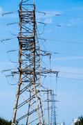 high voltage towers standing in line - stock photo