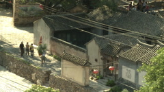 Tourists in Chinese mountain village Stock Footage