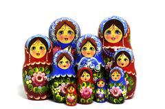Lot of traditional Russian matryoshka dolls on white Stock Photos