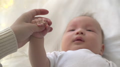 The mother and the newborn baby holds the hand when the child cries. From hand Arkistovideo