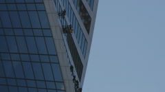 Industrial climber on skyscraper Stock Footage