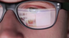 Closeup shot of boy in glasses surfing internet Stock Footage