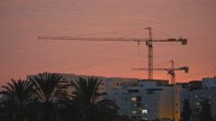 Tower cranes sunset Stock Footage