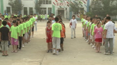 Morning exercises, migrant kids, China Stock Footage