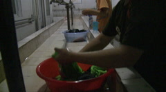 Migrant worker kids washing clothes, China Stock Footage