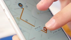 Close-up of an interactive map on a smartphone - stock footage