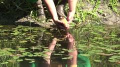 Fisherman let fish pond Stock Footage