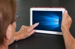 HEERENVEEN, NETHERLANDS, June 6, 2015: Tablet computer with Windows 10 backgr - stock photo