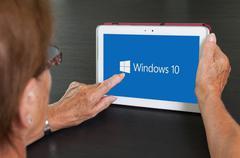 Stock Photo of HEERENVEEN, NETHERLANDS, June 6, 2015: Tablet computer with Windows 10 logo.