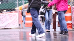 People walking on a wet floor in the streets of New York Stock Footage