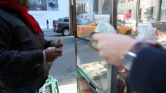 Paying a few dollars for a hot dog in New York Stock Footage