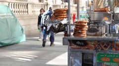 Delicious bretzel stand in New York City Stock Footage