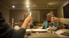 Happy senior couples cheering on christmas table Stock Footage
