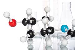 Molecular Structure and Beaker - stock photo