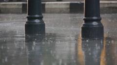 Raindrops on pavement Stock Footage